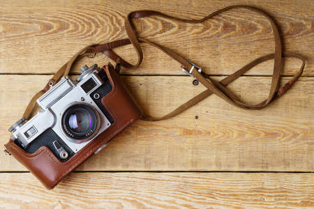 Old retro camera on wooden boards