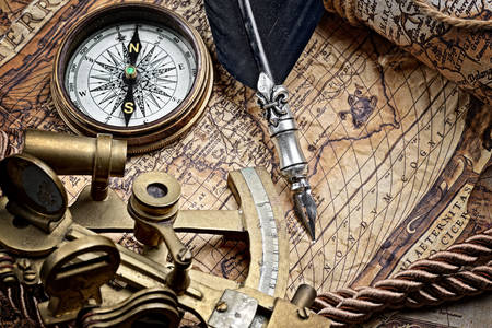 Sextant and compass on an old map