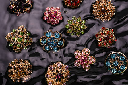 Brooches on the background of water