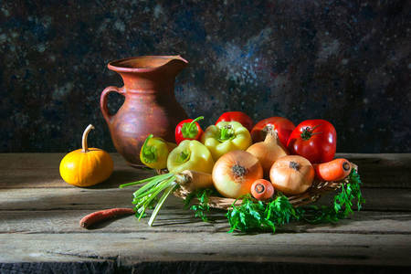 Vegetables and a jug on the table