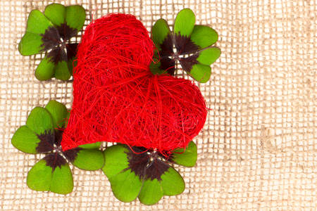 Red heart and clover on burlap