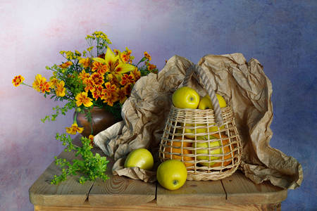 Apples in a basket and flowers