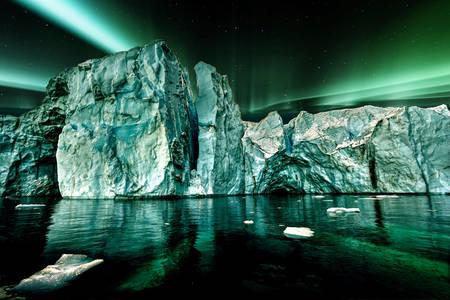 Northern lights over an iceberg