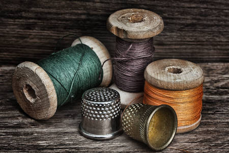 Spools of thread and thimbles