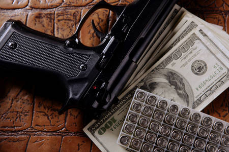 Dollar bills, pistol and cartridges