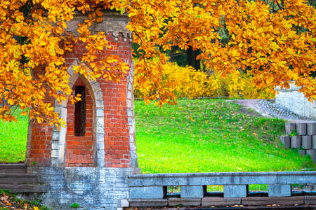 Brick tower in autumn park