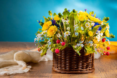 Basket of wildflowers on the table