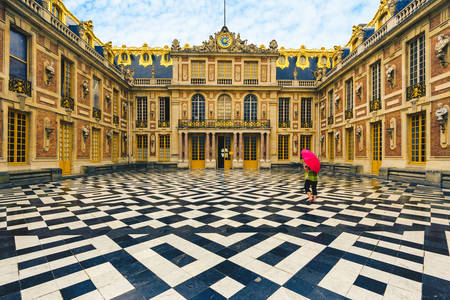 The marble courtyard of the Palace of Versailles