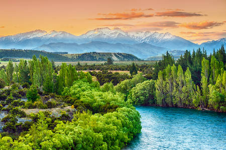 Sunset over the Kluta River with the Southern Alps in the background