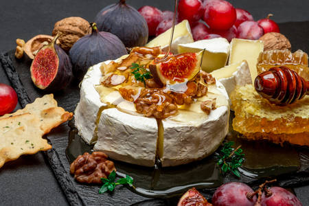 Camembert cheese with fruit and honey