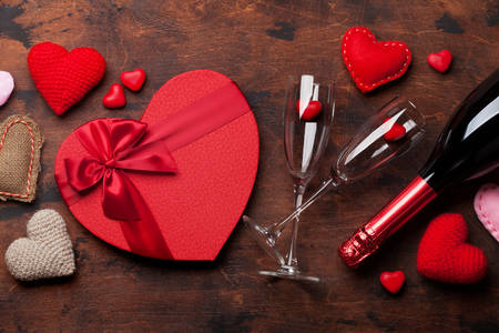 Heart-shaped gift, glasses and champagne