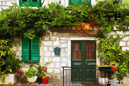 Casa in pietra con finestre verdi