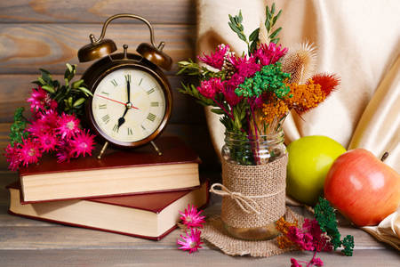 Clock on the table with flowers