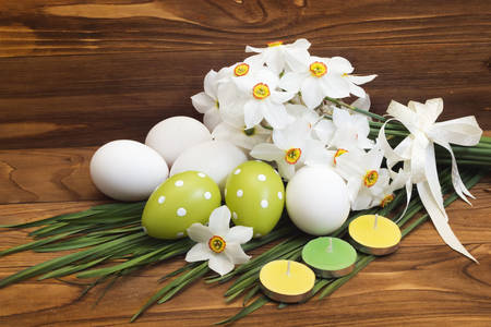 Easter eggs and a bouquet of daffodils