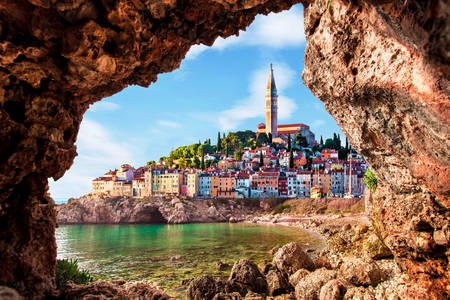 View of Piran through a rock hole