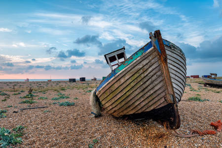 Old boat on shingle beach