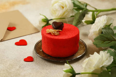 Red cake with chocolate heart