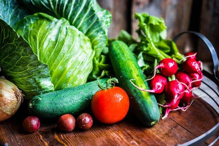 Fresh vegetables on a wooden tray
