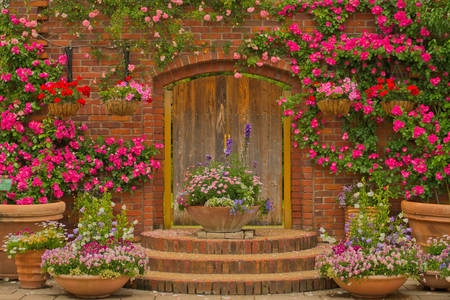 Wooden garden door in flowers