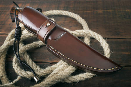 Hunting knife in a leather case