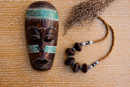 African mask and beads