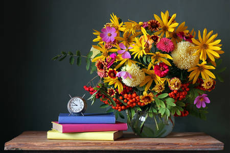 Bouquet and books on the table