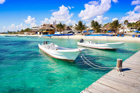 Boats on the beach in Puerto Morelos