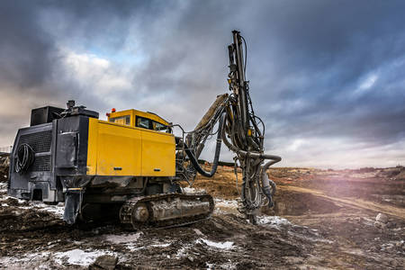 Excavator with drilling rig