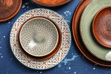 Clay and ceramic plates on the table