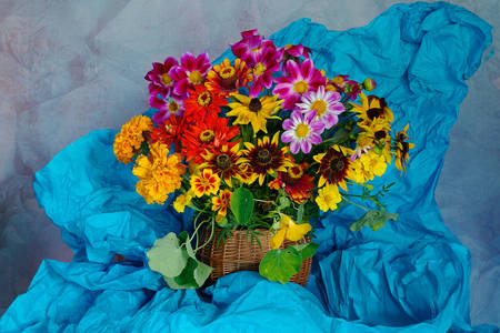 A bouquet of flowers in a basket