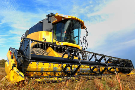 Yellow harvester in the field