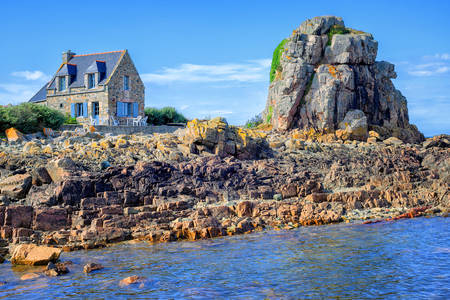 Stone house on a rocky shore
