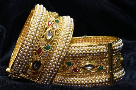 Gold bracelets with stones
