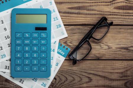 Calculator, calendar and glasses