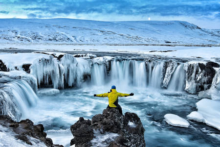 Man at Godafoss waterfall