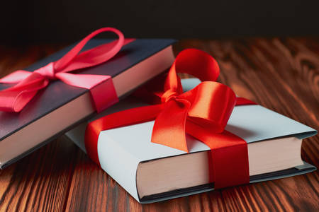 Books tied with a red ribbon