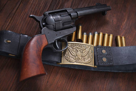Old revolver with cartridges
