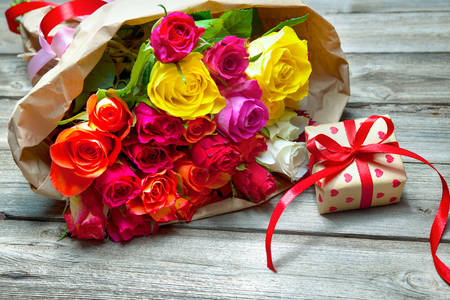 Bouquet of roses and a gift