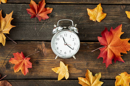 Clock with autumn leaves