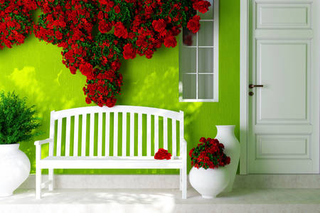 Red roses on a light green house
