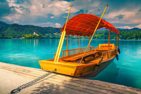 Pletna boat on the turquoise lake Bled