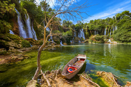 Boat at the Kravice waterfall