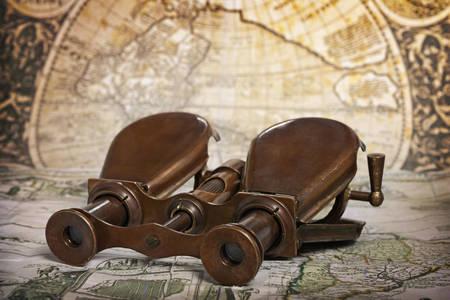 Vintage binoculars on the map
