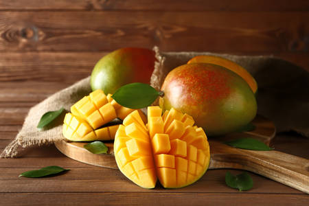 Mango on wooden board