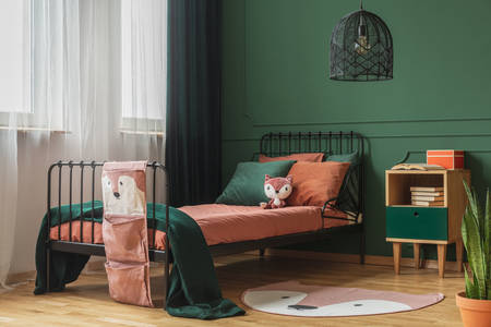 Children's bedroom in green and orange colors