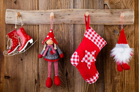 Christmas toys on wooden background