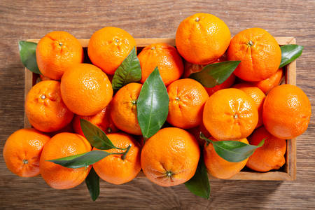 Tangerines in a wooden box