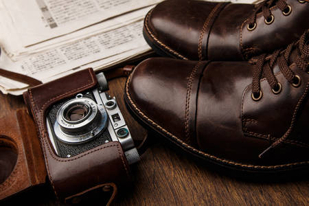Leather boots and camera