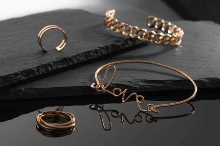 Bracelets and rings on a dark background
