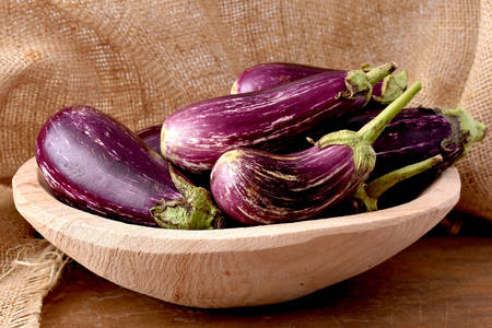 Eggplant in a wooden bowl